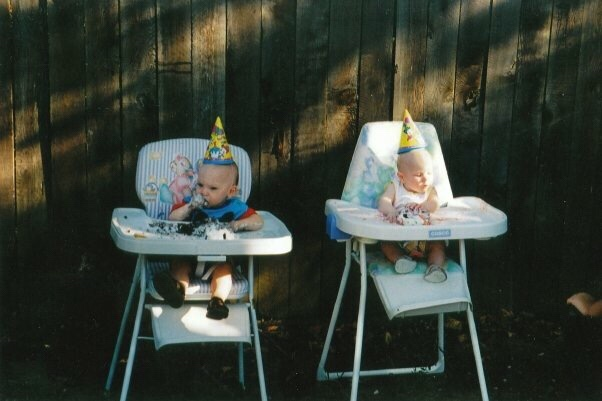 Chelsey and Clint wearing birthday hats and sitting in high chairs.